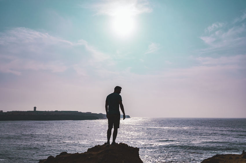 Beauty In Nature Cloud - Sky Full Length Horizon Horizon Over Water Land Leisure Activity Lifestyles Looking At View Men Nature One Person Outdoors Real People Rear View Scenics - Nature Sea Sky Standing Sun Sunlight Water Be Brave