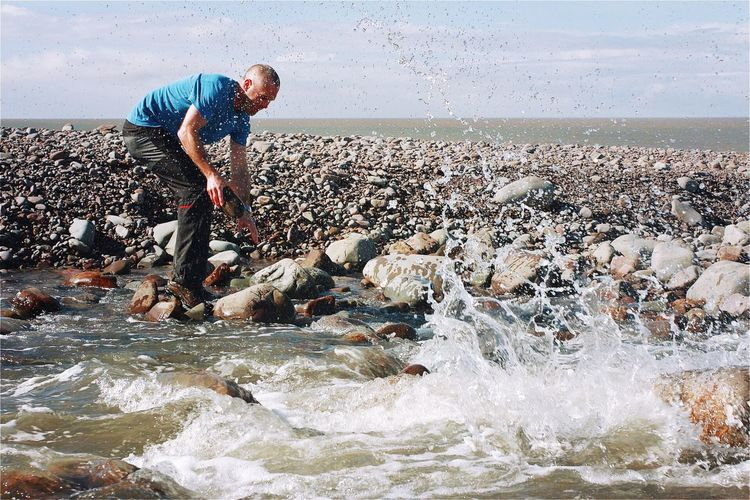 River crossing at Porlock beach on the Sourh West Coast Path, UK River River Crossing Splash Adventure Sea Nature One Person Men One Man Only Environment Working Adult Water Outdoors Beauty In Nature Digging Sky Adults Only People Only Men Day