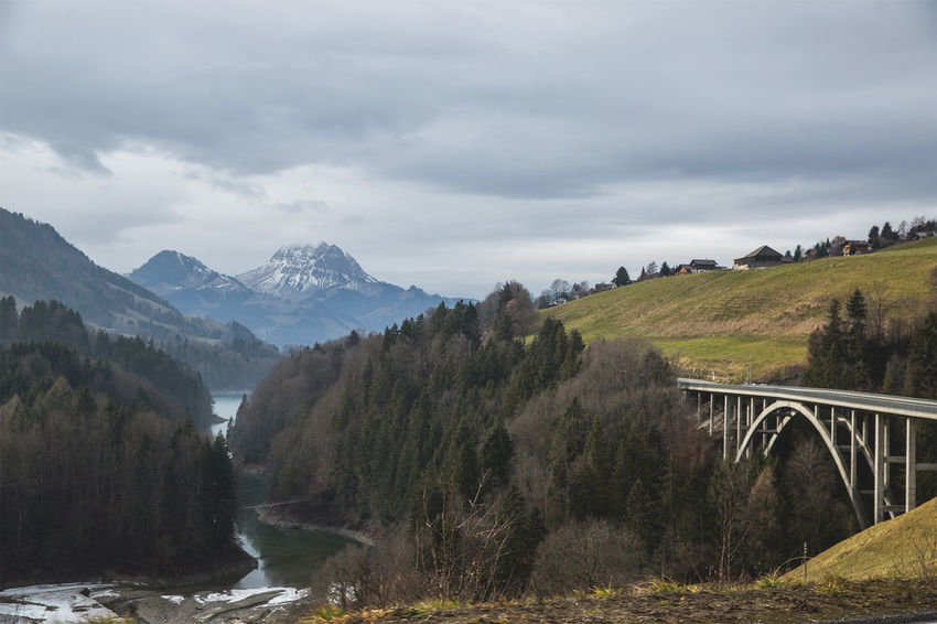 Bridge over swiss Landscape Beauty In Nature Cloud Cloud - Sky Cloudy Day Grass Green Color Growth Idyllic Landscape Mountain Mountain Range Nature No People Non Urban Scene Non-urban Scene Outdoors Overcast Plant Remote Scenics Sky Tranquil Scene Tranquility Weather