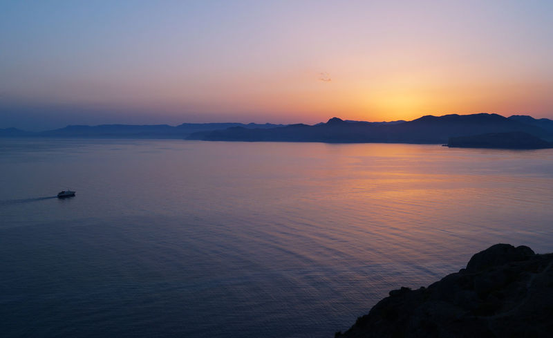 Summer sunset over the Sudak bay Afterglow Blue Hour Crimea Beauty In Nature Idyllic Meganom Mountain Nature No People Outdoors Sea Ship Sky Sunset Water Water Surface