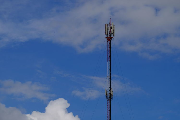 Cloud - Sky Sky Low Angle View Tall - High Tower Communication Technology Nature No People Day Architecture Built Structure Metal Connection Global Communications Crane - Construction Machinery Construction Industry Outdoors Blue Industrial Equipment Construction Equipment