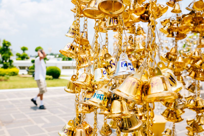 Wishes Fujifilm_xseries Bangkok Thailand One Person Gold Colored Day Full Length Representation Casual Clothing Real People Art And Craft Focus On Foreground Outdoors Sky Men Adult Nature Side View Standing Human Representation Incidental People Technology