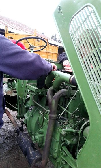 Human Body Part One Person One Man Only People Adult Adults Only Day Only Men Repairing Human Hand Men Occupation Working Outdoors Close-up Tractor Tractors Land Vehicle Tractor In A Field Tractor Love Farm Agriculture Rural Scene Agricultural Machinery Working