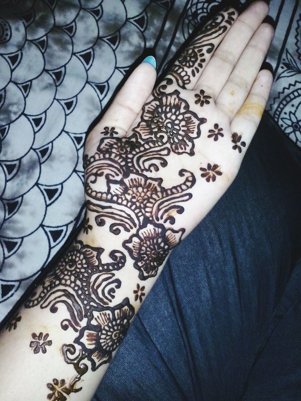 design, real people, human body part, one person, tattoo, human hand, indoors, high angle view, pattern, human leg, fashion, women, lifestyles, low section, close-up, day, adult, people