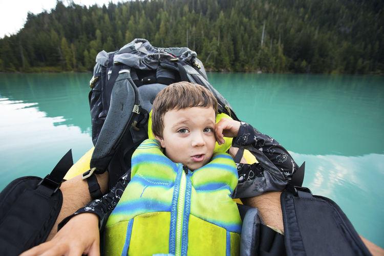 Portrait of boy in lake