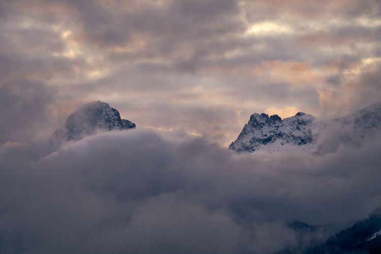 Low angle view of snowcapped mountain against sky during sunset