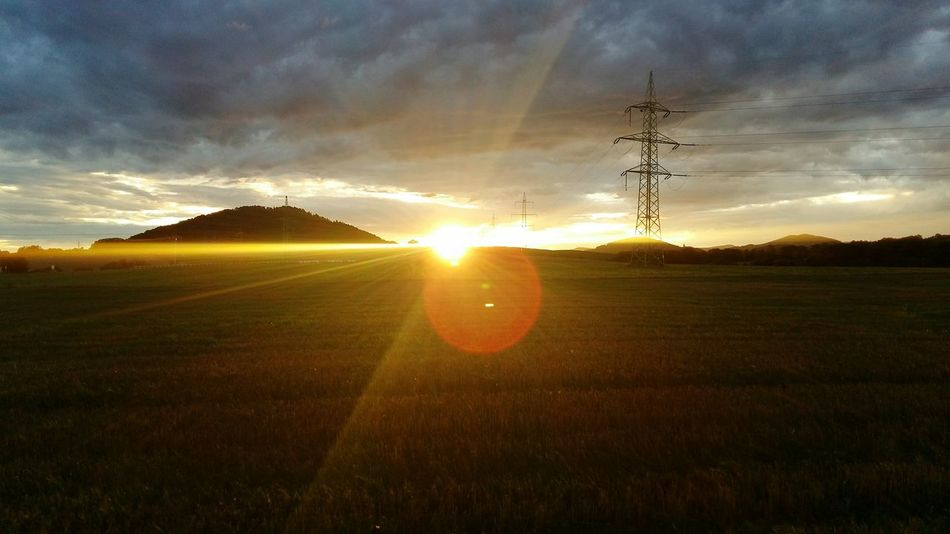 After Work Morning Good Morning Morning Sky Sunset Landscape Field Nature Sun Sunlight Sunshine Sky Scenics Beauty In Nature Outdoors Nature And Industry Factory Factory Zone Industrial Area Rural Scene Dramatic Landscape Dramatic Sky Electricity Pylon Electricity  Tranquility