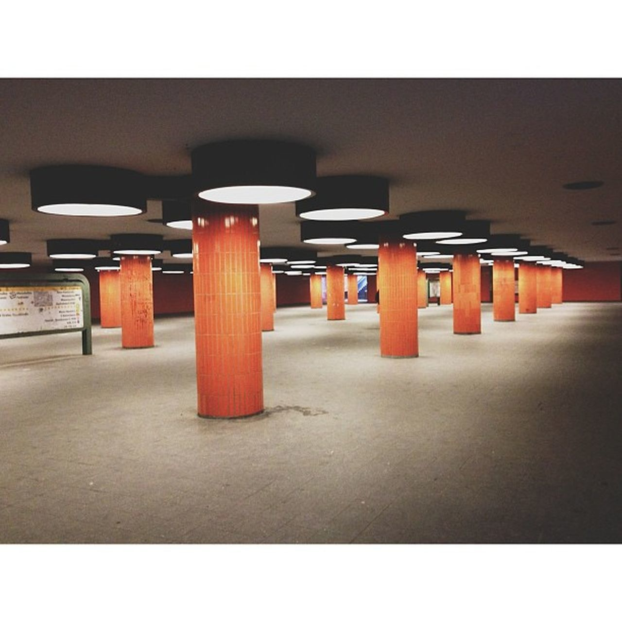 in a row, architectural column, illuminated, ceiling, architecture, built structure, no people, indoors, pillar, parking garage, day, basement