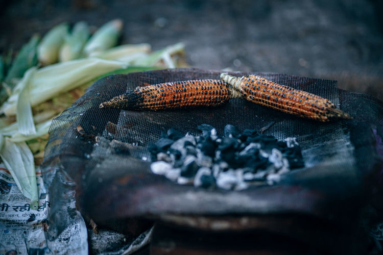 Close-up of corns on barbecue grill
