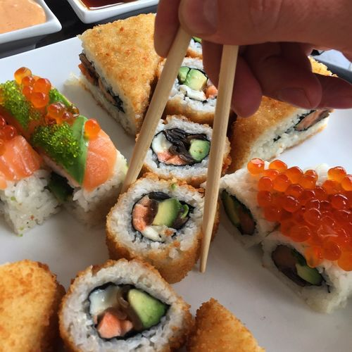 Sushi Food And Drink Food Seafood Ready-to-eat Freshness Sushi Healthy Eating Indoors  Human Hand Close-up SLICE One Person Serving Size Cultures Day Human Body Part