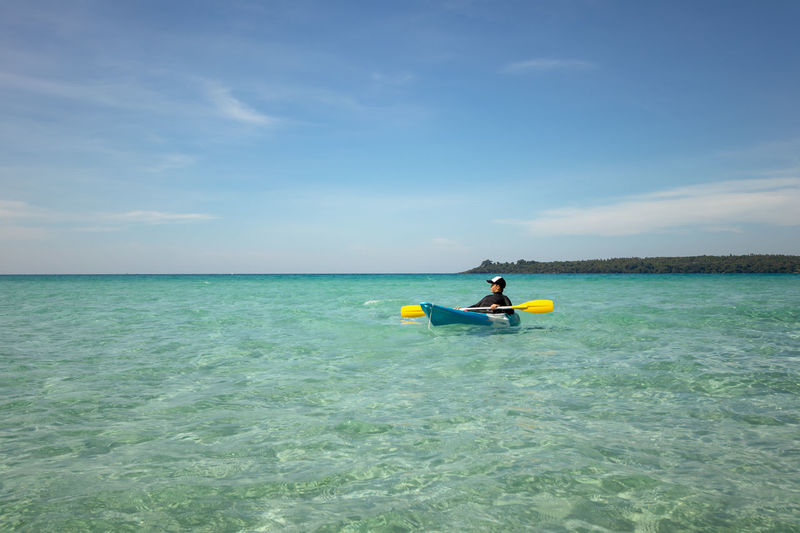 Boy kayaking at sea Sea Water Sky One Person Horizon Over Water Real People Beauty In Nature Waterfront Scenics - Nature Horizon Leisure Activity Lifestyles Day Nature Nautical Vessel Sport Adventure Tranquility Outdoors Turquoise Colored