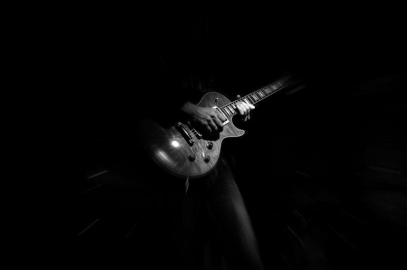 Black Background Blackandwhite Blackandwhite Photography Code Of The Road Darkroom Eye4photography  EyeEm Best Shots EyeEm Gallery Getting Inspired Guitar Shootermag EyeEm Masterclass Fine Art Photography Play It Loud Monochrome Photography Men Musical Instrument Performance