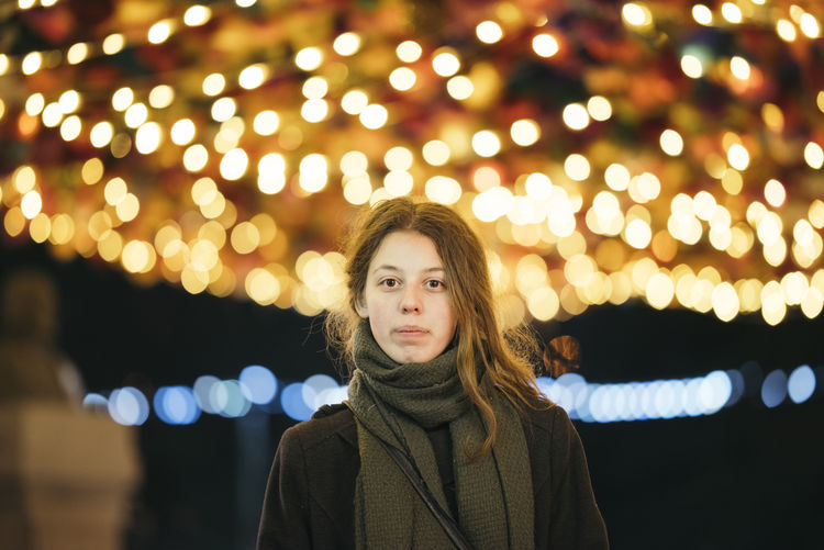 Beautiful Woman Christmas Lights Close-up Focus On Foreground Front View Illuminated Leisure Activity Lifestyles Looking At Camera Night One Person Outdoors Portrait Real People Standing Warm Clothing Winter Young Adult Young Women EyeEmNewHere