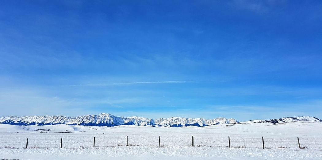Slightly different shot of the Rockies in Alberta, Canada 🏔 Snow Winter Cold Temperature Blue White Color No People Frozen Sky Nature Day Landscape Cloud - Sky Outdoors White EyeEmNewHere Copy Space Canada Alberta Rocky Mountain Rocky Landscape Rockymountains Rocky Mountains Beauty In Nature Polar Climate Winter