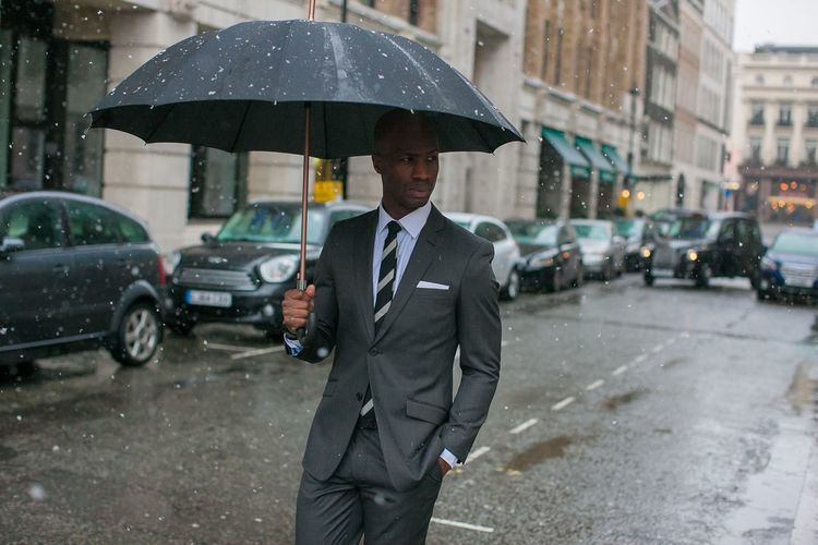 The weather may challenge us, but our attire should not! Suiting piece shot for Dobell Menswear Fashion London lifestyle Suit Mensfashion Umbrella Rain City Wet Transportation Protection Street Men City Life Businessman Car City Street One Person Business Rainy Season