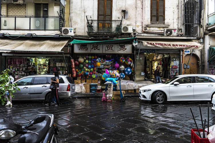 still raining in chinatown Chinatown Naples Campania Italy Rain In Chinatown EyeEmNewHere EyeEm Best Shots HardKnocks Street Streetphotography Vita Dura Streetlife Street Trader Little China Trick Or Treat Real People Architecture Car Motor Vehicle Building Exterior Outdoors No Filter