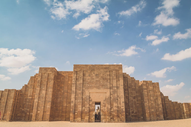 Sky Day Nature Outdoors Egypt Travel Destinations Sakkara Ancient Civilization Ancient Architecture Travel Tourism Camel Desert Cloud - Sky Architecture History The Past Built Structure Ancient Low Angle View Building Exterior City Old Ruin Sunlight Place Of Worship Archaeology Ruined