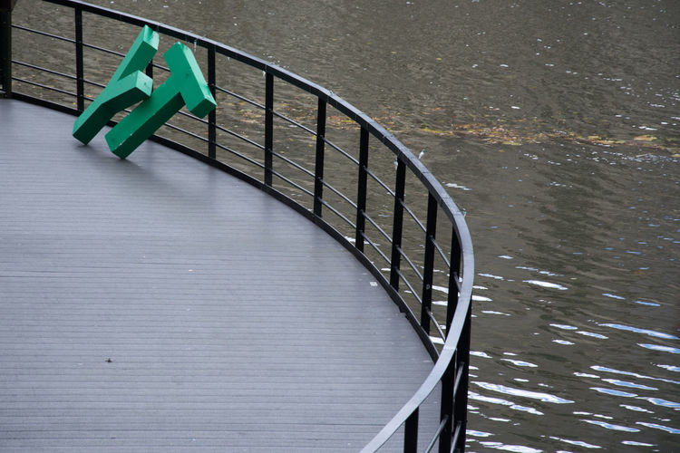 High angle view of railing in water