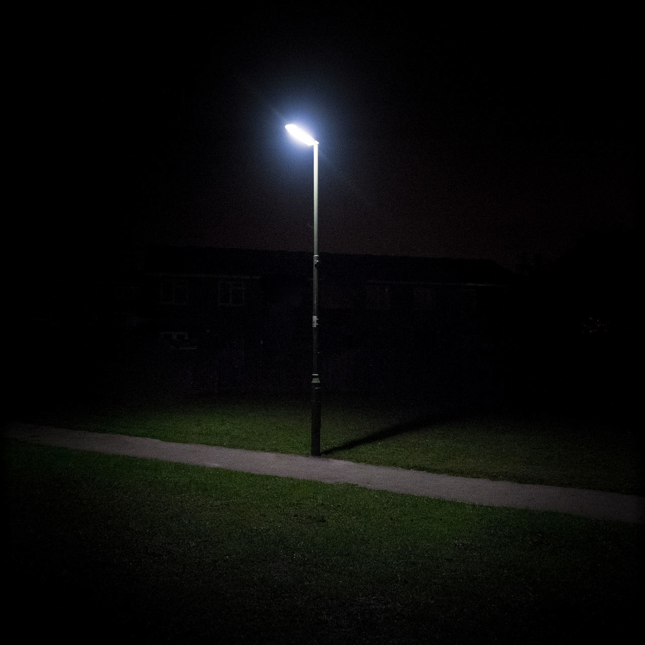 Street lamp illuminating footpath