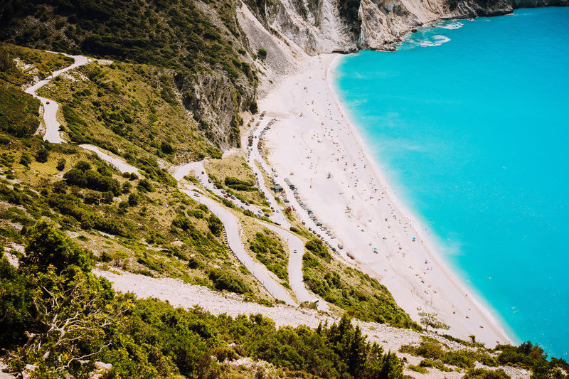 Serpentine road to famous Myrtos Beach. Favorite visiting place on Kefalonia, Greece Kefalonia, Greece Road Bay Beach Beauty In Nature Blue Day Environment High Angle View Idyllic Mountain Myrtos Beach Nature Non-urban Scene Outdoors Plant Scenics - Nature Sea Summer Tourism Tranquil Scene Tranquility Turquoise Colored Water Zigzag