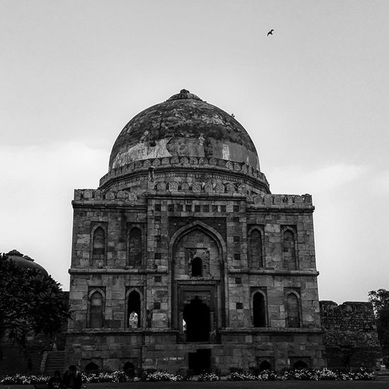 Low angle view of old ruin lodhi tomb against cloudy sky