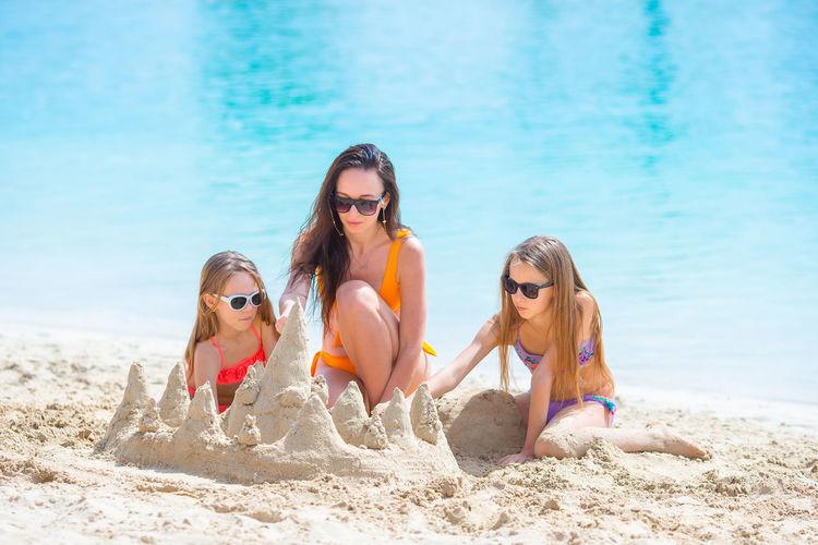 Women wearing sunglasses on beach