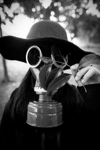 Close-Up Of Woman In Gas Mask