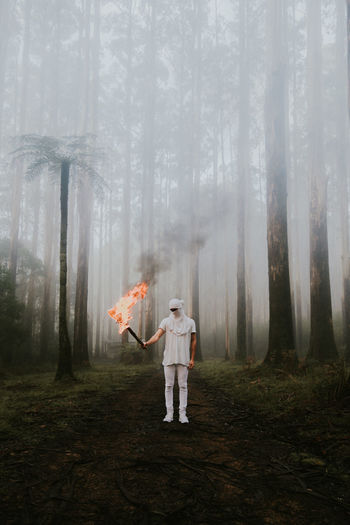 Anonymous Flame Nikon Day Dreamlike Fantasy Fire Fog Forest Front View Full Length Land Mysterious Mystery Nature One Person Outdoors Plant Standing Tree White Women WoodLand The Great Outdoors - 2018 EyeEm Awards The Traveler - 2018 EyeEm Awards