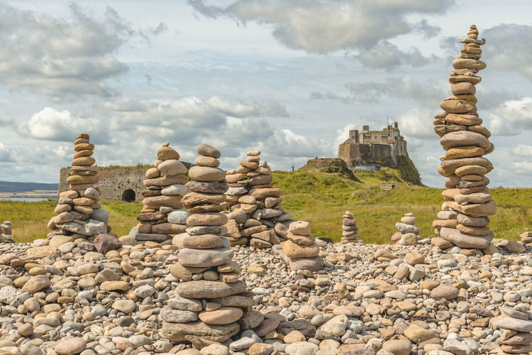 Lindisfarne view Castle Lindisfarne Castle Arrangement Balance Beauty In Nature Cloud - Sky Day Landscape Large Group Of Objects Lindisfarne Nature No People Outdoors Pebble Rock - Object Sky Stack