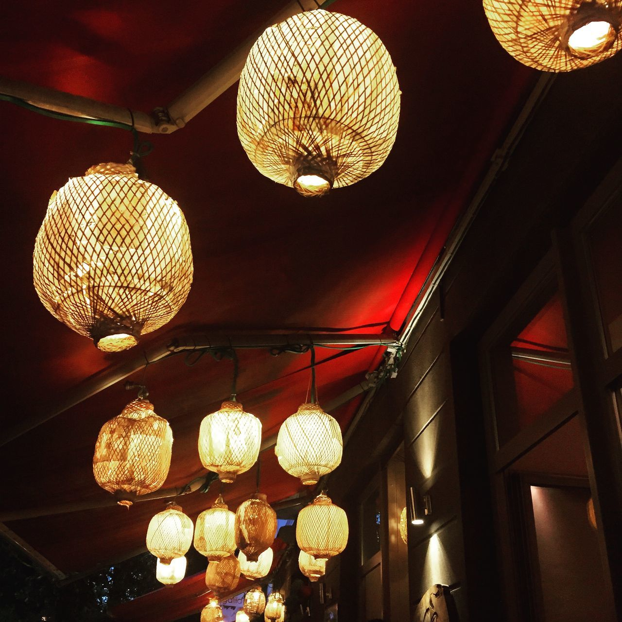 hanging, lighting equipment, low angle view, ceiling, illuminated, indoors, electricity, no people, lantern, light bulb, technology, day