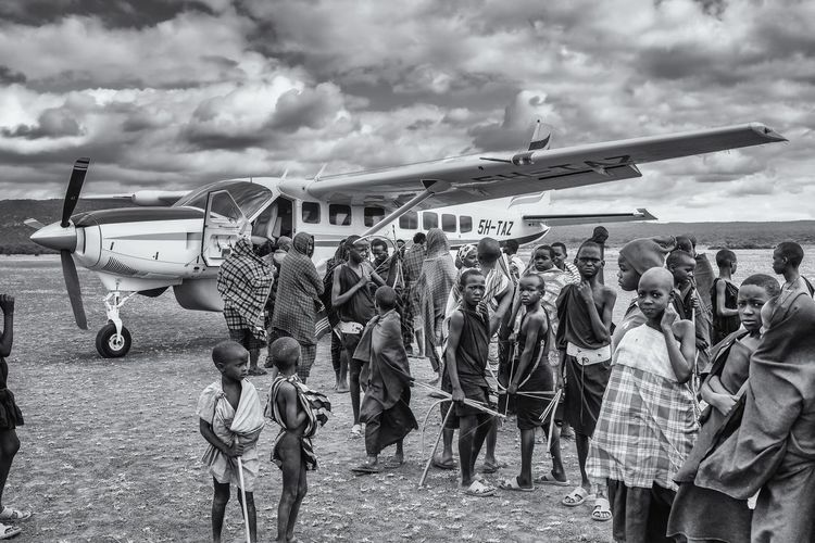 The strange bird Africa,Tanzania, Masaai Tribes Crowd Masaai Steppes Outdoors Spectator Transportation