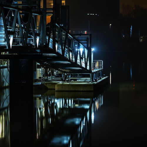 Pedestrian bridge Hamburg Harbor Long Exposure Nightphotography Water Reflection Railing Calm Water Illuminated Reflection Night Architecture Built Structure No People Business Table Building Exterior Outdoors Water Connection Lighting Equipment Empty