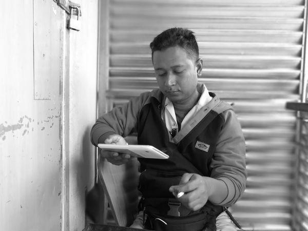 Occupation Men Technology Working Waist Up via Fotofall