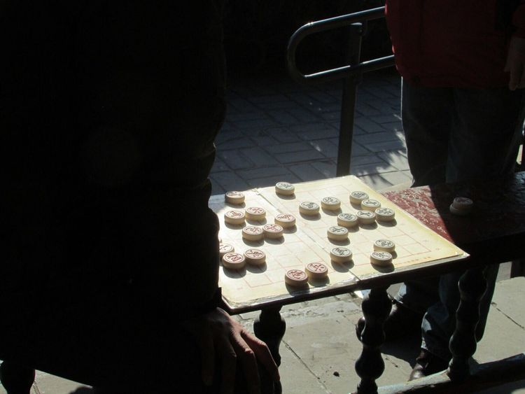 Eyeemphoto Beijing China Tourist Chinese Chess Board Game Men Domestic Life Personal Perspective Silhouette Sunlight Travel Photography
