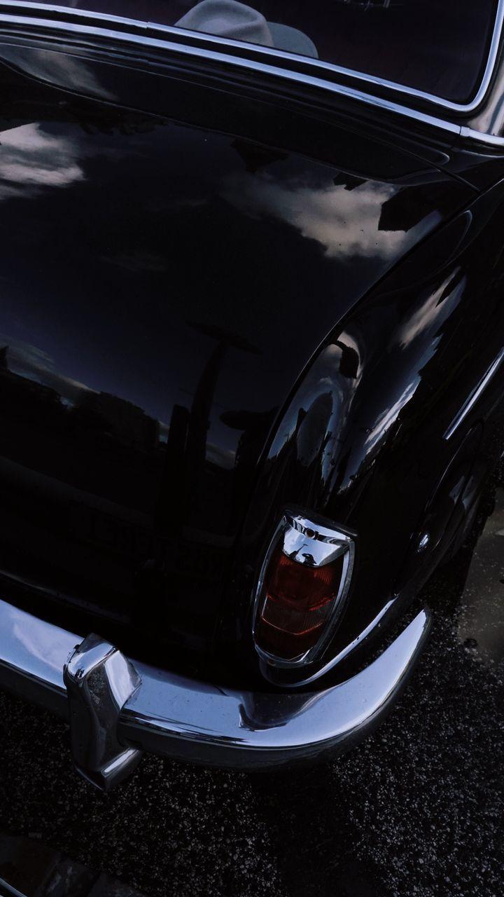 HIGH ANGLE VIEW OF CAR HEADLIGHT