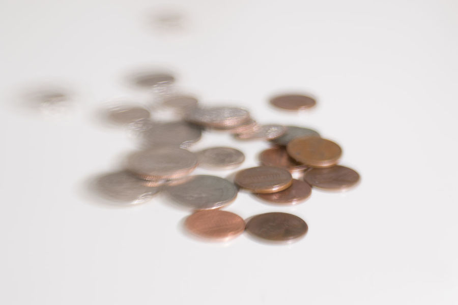 This is an artistic image shot with the image of money and how its always moving up or down due to inflation and markets American Money EyeEm Best Shots Penny Quarters Still Life Photography Artistic Photo Change Close-up Coin Coins On The Table Day Dime  Dofaddicts Finance Howard Roberts Indoors  Inflation  Large Group Of Objects Loose Change Nickle No People Selective Focus Studio Photography Studio Shot White Background