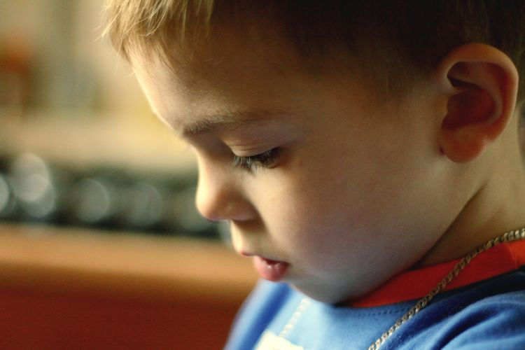 Close-up of boy looking down