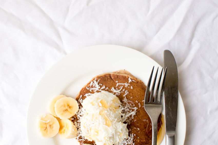 Coconut banana pancakes from above Breakfast Close-up Dessert Directly Above Eating Utensil Food Food And Drink Fork Freshness High Angle View Household Equipment Indoors  Indulgence Kitchen Utensil No People Plate Ready-to-eat Still Life Sweet Sweet Food Table Knife Temptation