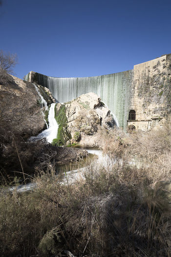 Views of the Elche swamp in winter. Province of Alicante in Spain. Agriculture Elche Scenic Swamp Vinalopo Architecture Beauty In Nature Built Structure Cascade Clear Sky Day Grass Irrigation Nature No People Outdoors Reservoir Scenics Travel Destinations Waterfall