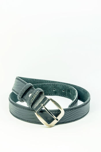 A type of belt use for men. Accessory; Belt; Black; Chrome; Classic; Close-up Comfort; Costume; Design; Elegance; Fashion; Hole; Lock; No People Personal; Roll; Silver; Simple; Single; Strap; Studio Shot Vinyl; Waist; Wear; White Background