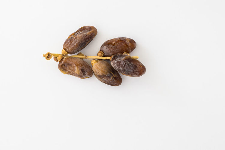 Dates or kurma over white background Close-up Dates Fasting Food Freshness Kurma Muslim No People Ramadhan Top View