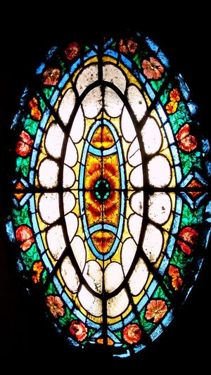 Stained Glass Multi Colored Window Pattern No People Indoors  Old-fashioned Rose Window Close-up Place Of Worship