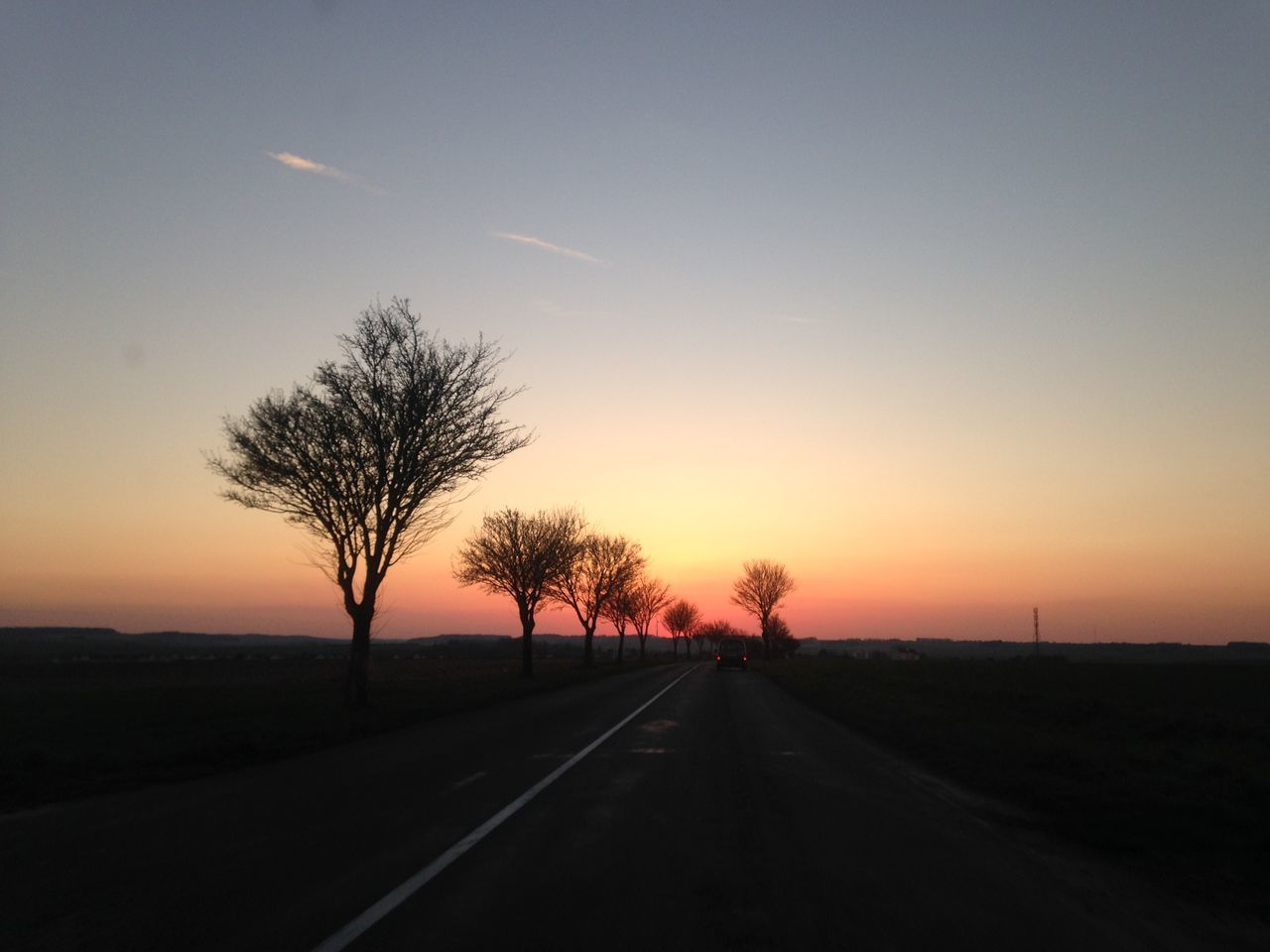 Country Road Against Sky During Sunset