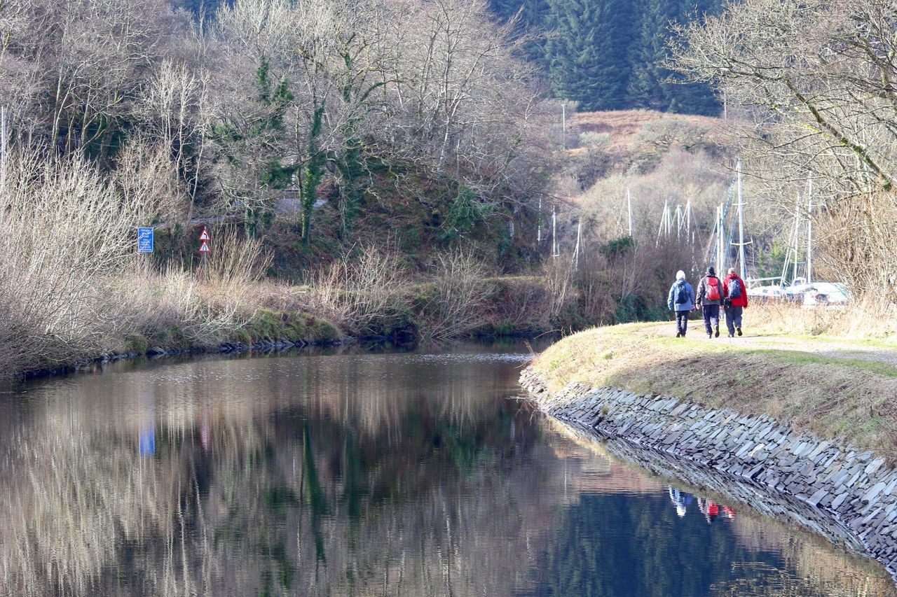 Rear View Of People By Crinan Canal
