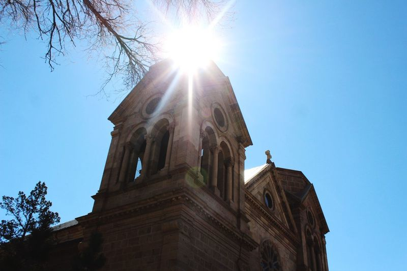 Holy place Church Sky Low Angle View Built Structure Architecture Building Exterior Sunlight Nature Clear Sky Sunbeam Sunny Plant Lens Flare City Building Day Travel Destinations History Sun Tree