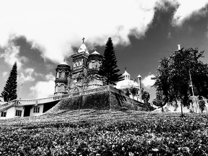 Black and white shot of a Church surrounded by a tea plantation in Kerala, India Scenics