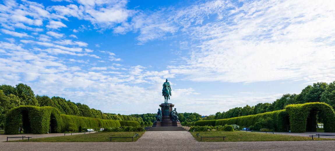 Statue in formal garden of schwerin palace against sky