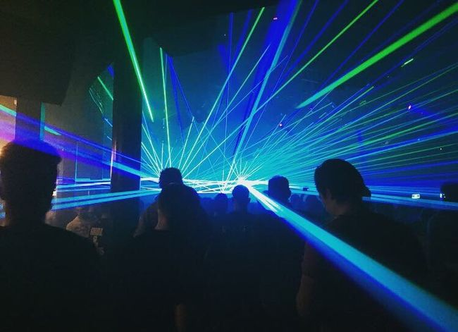 Be. Ready. Nightlife Arts Culture And Entertainment Nightclub Enjoyment Music Fun Popular Music Concert Light Beam Lighting Equipment People Illuminated Multi Colored Clubbing Large Group Of People Night Men Excitement Party - Social Event Audience Laser