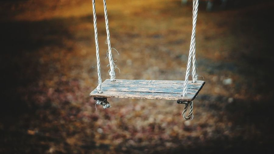 Close-up of swing hanging at playground