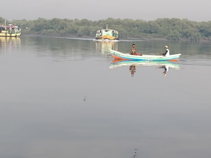 Water Nautical Vessel Transportation Mode Of Transportation Waterfront Real People Lake Two People Reflection Men Nature Day Travel Leisure Activity People Lifestyles Sky Adult Outdoors